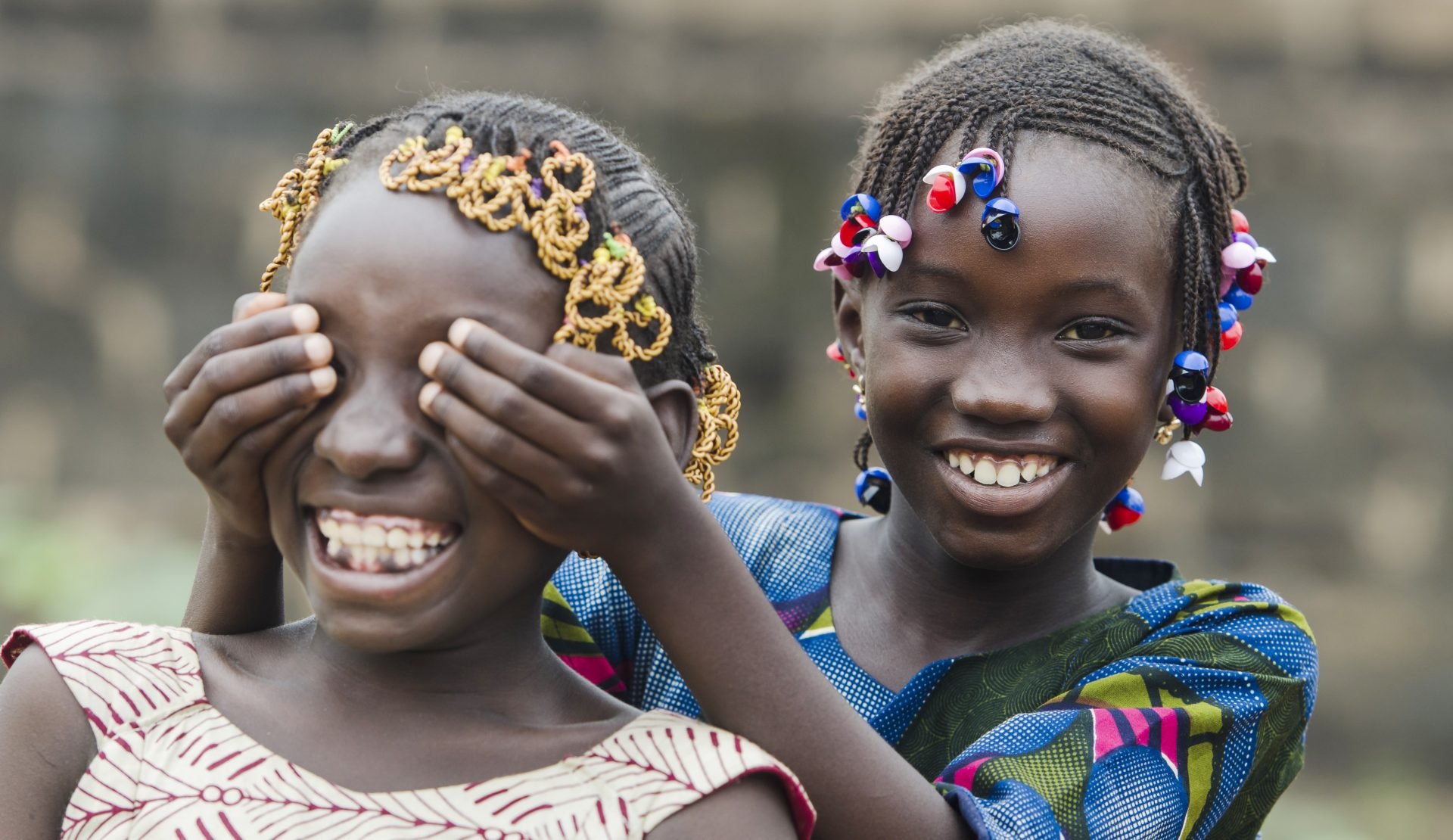 Two youg girls, probably in Africa.