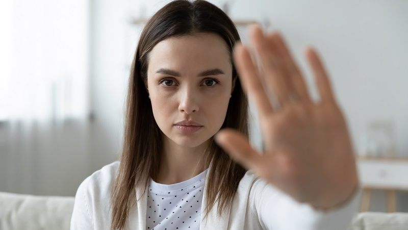Woman rejects with her hand