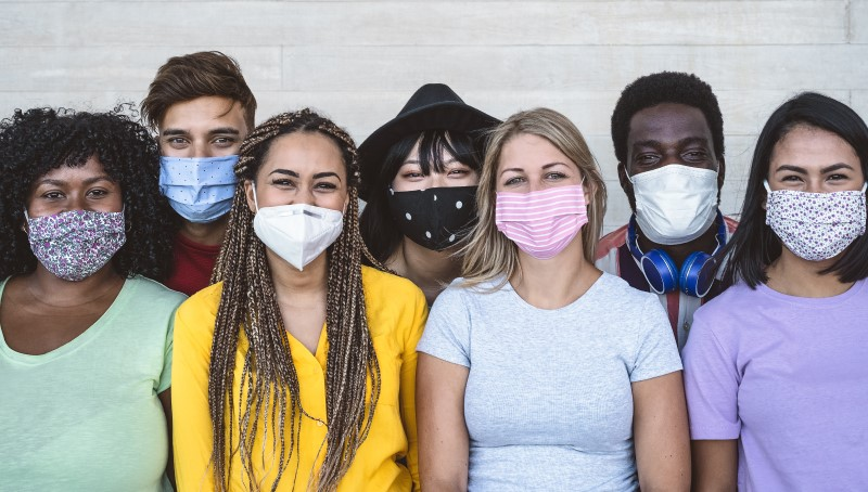 Group of young people with facemasks.