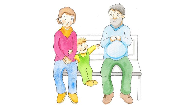 Äiti ja lapsi istuvat puiston penkillä. Vieressä istuu mies, jonka pyöreää mahaa lapsi osoittelee.